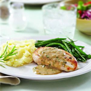 This creamy sauce is a classic with chicken - and while tarragon is the traditional herb, thyme or rosemary would also work beautifully. Serve with sauteed string beans and wild rice.