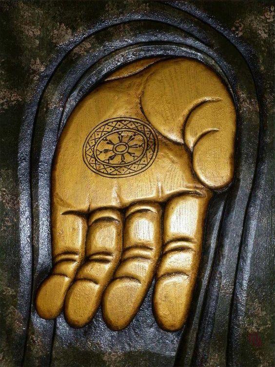 the wheel of dharma on Buddha's hand