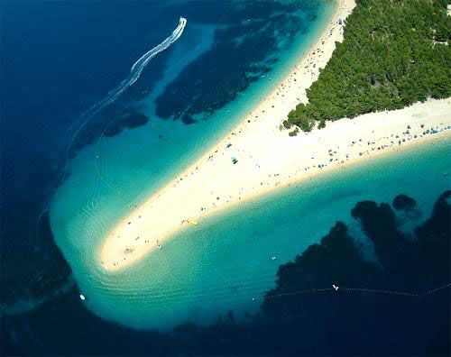 Zlatni Rat, Croatia. It is a pebble beach on a promontory near Bol, Croatia. The shape of the beach shifts with changes in the tides, currents and wind.