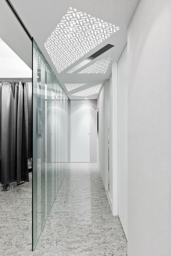 Luxurious Clinic Interior Design in Neutral Colors: Bright Clinic By ATELIERII Interior Glass Room Divider Marble Floor: