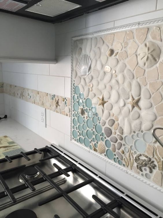 """This custom 18""""x18"""" handmade mosaic kitchen backsplash has a matching 4"""" border that wraps around a good portion of this beautiful kitchen. Using glass, stone, and various glazed ceramic pieces, we created this mural + border combo and we think it fits this kitchen pretty well! #wetdogtile:"""