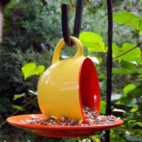 Cute DIY bird feeder. Thinking maybe charity shop materials?