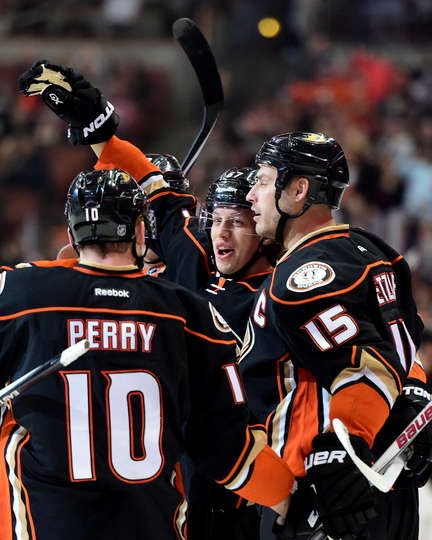 Rickard Rakell #67 of the Anaheim Ducks celebrates his goal with Ryan Getzlaf #15 and Corey Perry #10 to take a 1-0 lead over the wp during the first period