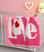 """Perfect for expressing your love, crochet this graphic """"LOVE"""" throw for baby, child or as an adult lap throw. We show it in pinks with a red heart, but any colors can be substituted."""