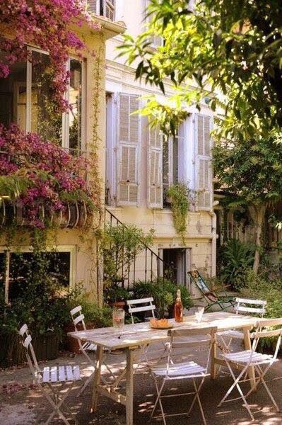 Romantic outdoor dining with French bistro chairs and table. Romantic French Country Garden Courtyard Ideas. #frenchcountry #garden #courtyard #dining