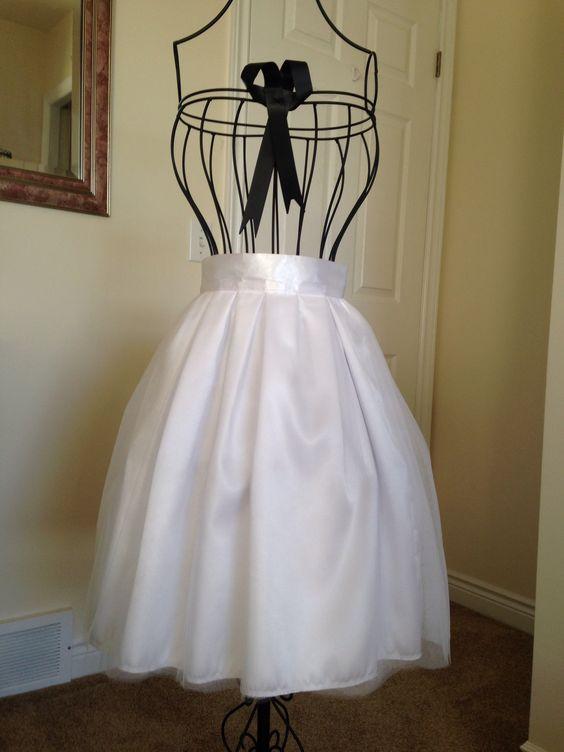 "Beautiful satin and tulle skirt.  Waist 24"". Length 21"".  $50.00"