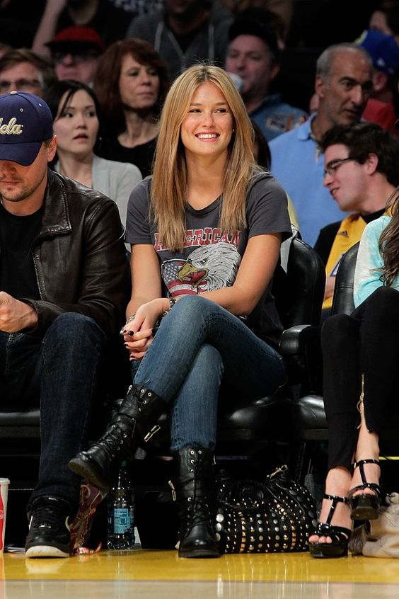 Pin for Later: The REAL Reason We're Loving Basketball?  Bar Refaeli kept things rocker-cool in a vintage tee and motorcycle boots for a Lakers game in January 2010.