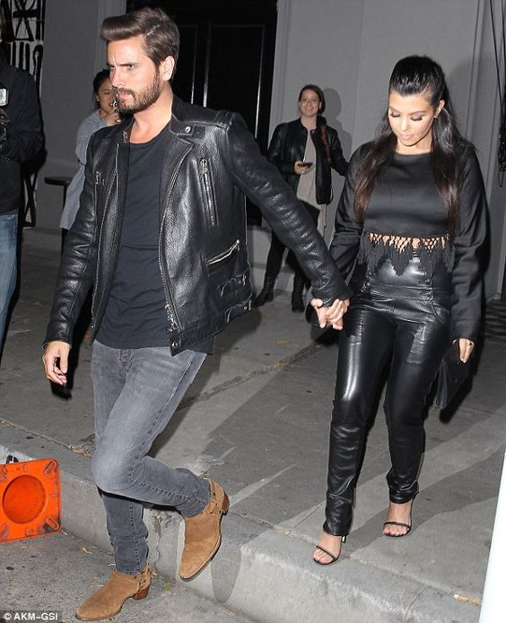 United front: Scott and Kourtney were seen holding hands as they left Craig's Restaurant in LA on Thursday night after dining with other family members including Khloe
