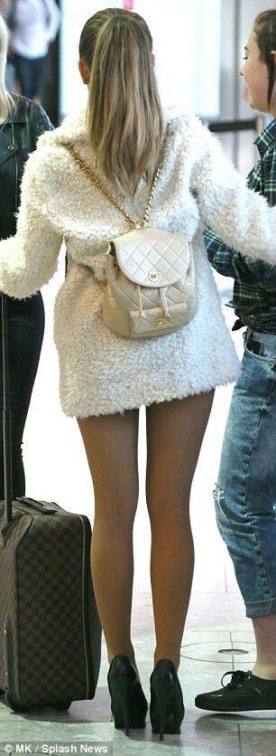 Ariana Grande jets into London in a cute fur coat