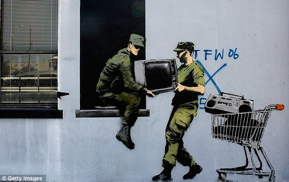 Famous banksy mural painted over by rival street artist in for Banksy mural painted over