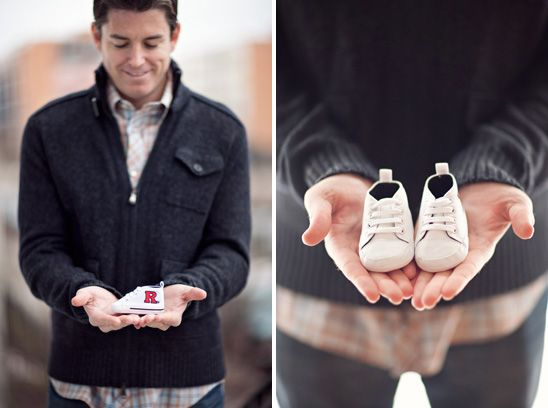 Expecting dad holding tiny baby shoes featured on Onto Baby photos by STUDIO 1208