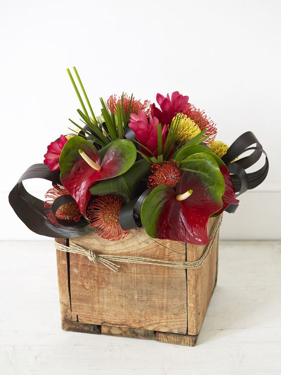 Escape to the tropics with an exotic floral centerpiece - Wooden containers for flowers ...