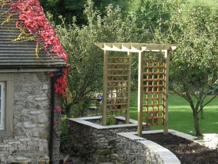 An archway between the two raised beds - for growing beans on?