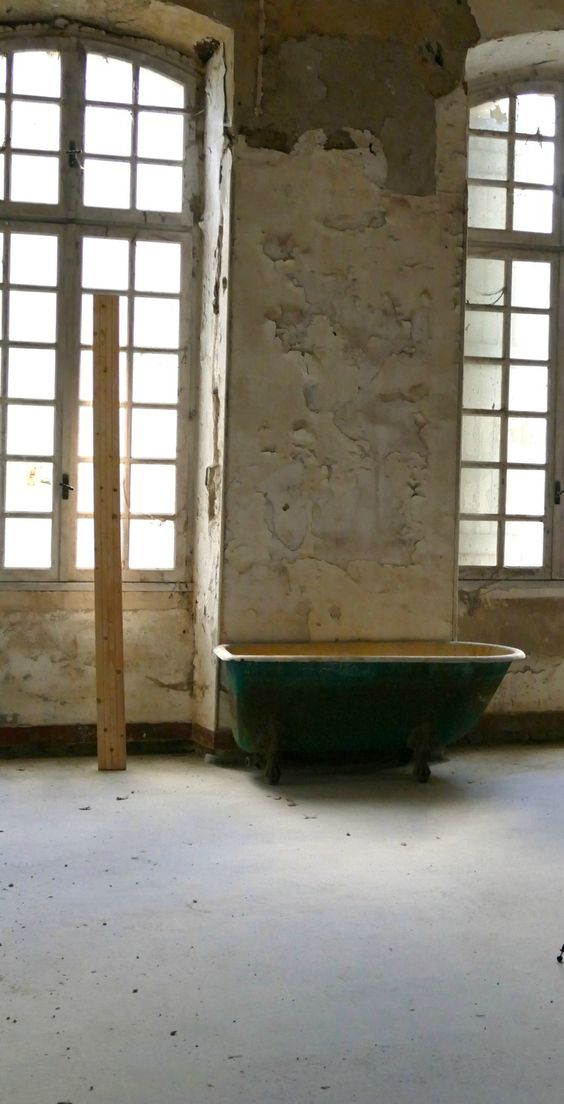 Decaying walls and distress in a bathroom at Chateau de Gudanes. Weathered Walls & Déshabillé Lovely. #French #chateau #renovation #walls #weathered #distress #windows
