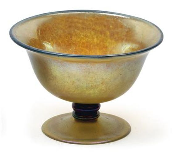 A tazza,  Lötz Witwe, Klostermühle c. 1920, the colourless glass covered with a dense pattern of silver-yellow specks, cobalt blue rim line and triple ring knop, iridescence, height 14 cm