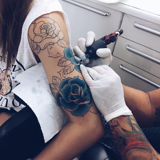 blue rose sleeve tattoo in the making