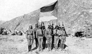 Arab rebels with the British-designed Flag of the Arab Revolt