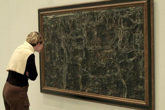 ": A young lady looks at ""Paysage charbonneux"" by French artist Jean Dubuffet dated 1946, and valued at 3.5 million Marks (1.5 million Dollars) at the 34th International fair for modern art ""Art Cologne"" in Cologne, Germany, Friday, November 3, 2000."