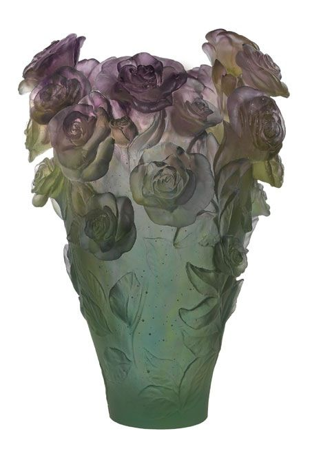 Lalique. Not a really great fan of Lalique, mostly because of the heaviness of the pieces. Even when they are meant to be light and airy or fairylike, they drag at the senses.: