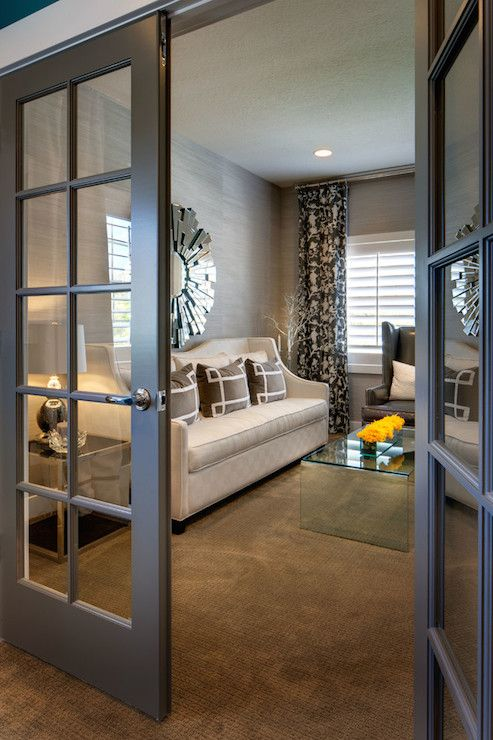 Gray french doors open to chic living room boasting for French doors that both open