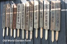 making garden signs from old barn wood, crafts, gardening, The finished garden signs on the deck waiting to be placed in the garden