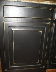 distressed black cabinets like the sheen and amount of distress on this one.