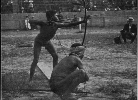 """Africans are shown participating in archery in 1940 in St Louis at an event called the """"Savage Olympics Exhibition"""""""