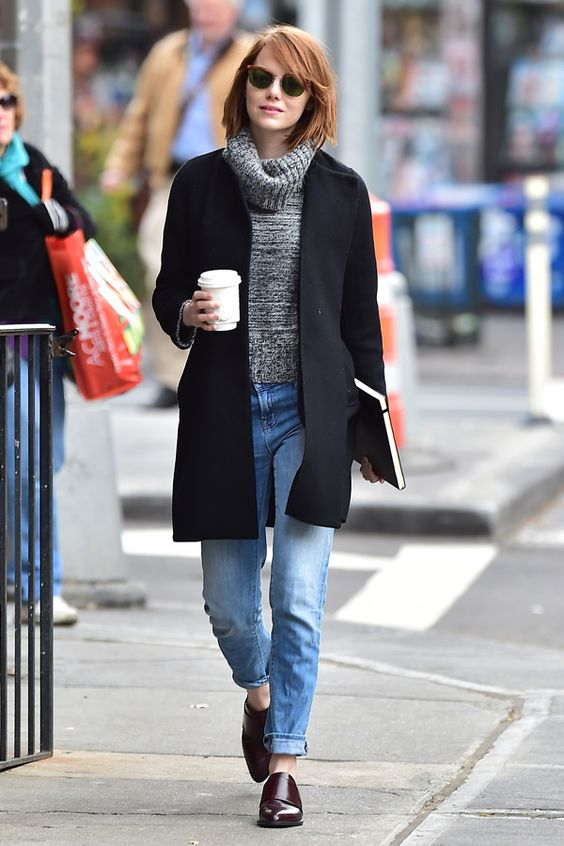 Emma Stone's Best NYC Outfits #refinery29  http://www.refinery29.com/2014/12/79691/emma-stone-best-new-york-outfits#slide7  On Halloween, Stone was spotted grabbing coffee in a much chicer iteration of our fall uniform. Her cropped turtleneck aligns perfectly with the waistline of her boyfriend jeans — but, the bagginess of the look is polished by a sleek open coat and a shiny pair of loafers.: