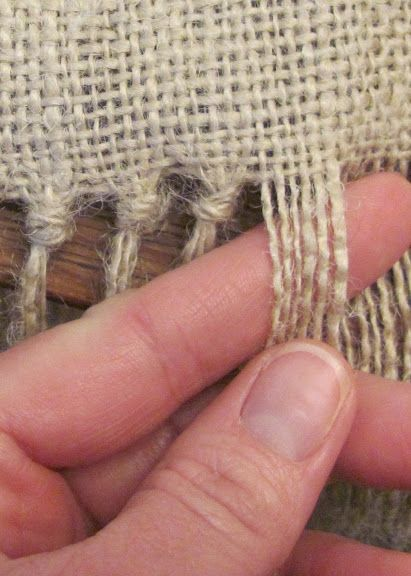 Burlap fringe- great for the finishing touch on window panels or a shower curtain....