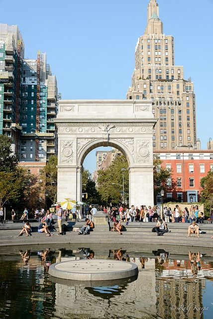 Washington Square Arch was designed by Stanford White. He modeled the arch after the 1806 Arc de Triomphe in Paris. In the foreground is the the Central Fountain (which was off at the time of this picture). New York City