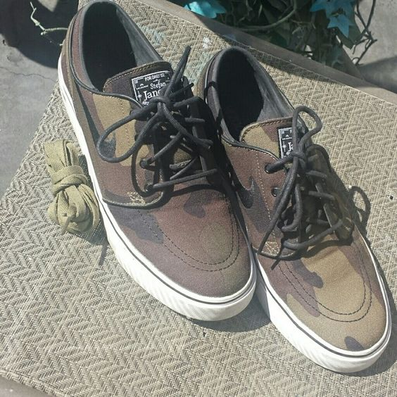 Nike Stefan Janoski Camouflage Sneakers Canvas. Original box, original laces & original second pair army olive green brand new laces. Preowned in excellent condition, a few scuffs on white leather, which probably can be cleaned. Nike Shoes Sneakers