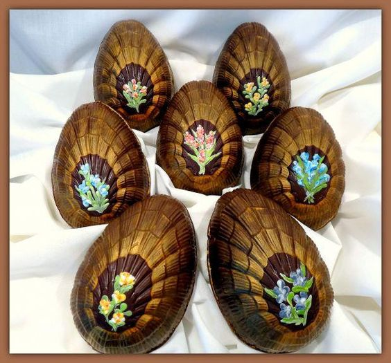 These hand painted hollow chocolate eggs make a perfect gift. Covered front and back with edible gold luster and individually hand painted flowers (front side only) in colored cocoa butter. Perfect for Easter!  Weight ~ 4 oz. Size ~  4 in. x  3 in. (H x W) Packaged in gift box & colored ribbon. Includes special care instructions. Eligible for nationwide shipping. Currently available in 58% Callebaut Dark chocolate only. Does contain dairy and soy products.