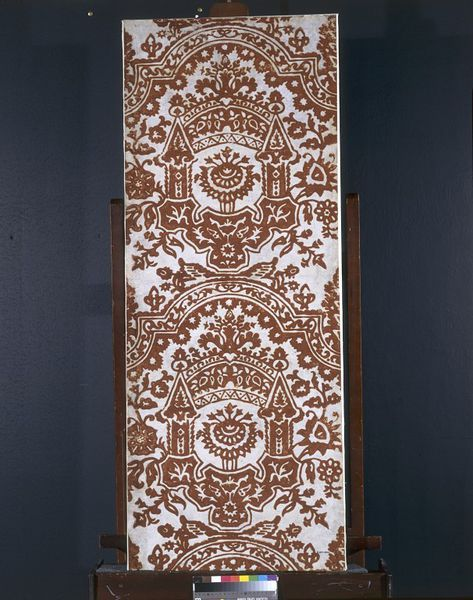 Panel | Netherlands or Great Britain, made ca. 1680, This is part of a very unusual wall decoration. Embossed leather was a fashionable wall covering at this date, but the flock wallpaper is the earliest example to be found in this country. There is no other known example of panels of leather and flock hung in alternating panels in this way.