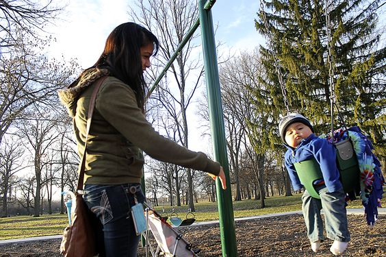 Miriam Weyer, of Ames, enjoys some playtime with her 10-month-old son, Rigo Weyer, on the swings at Brookside Park in Ames on Wednesday. Photo by Michael Crumb/Ames Tribune