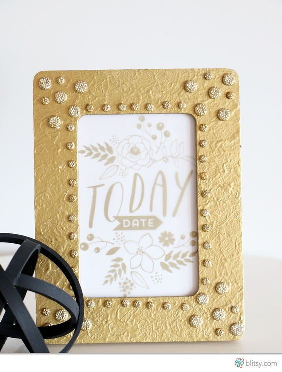 Bling is always better! See how we dressed up this plain wood frame with gesso, spray paint, and bling stickers.