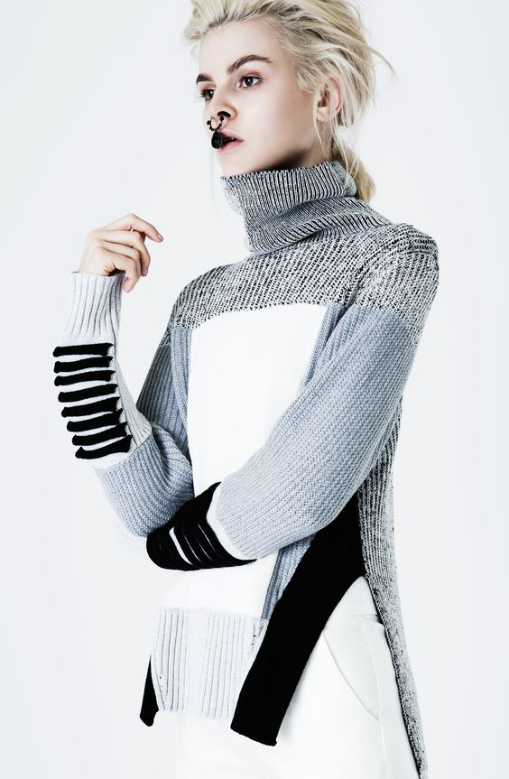 PRE-ORDER Expected Arrival 23rd – 27th May Roll neck sweater that features contrast knit panelling. The sweater features contrast ladder ribbed detail along the back of the sleeve cuffs. The knit is loose fit in shape and features side splits that begin from the lower waistline. Knit features a large ribbed hemline tat finishes on the hipline. 100% Cotton | Cold Hand Wash/Dry Clean Only | Made in PRC Runs true to size. Sizing in AUS. Model wears size 6. ...