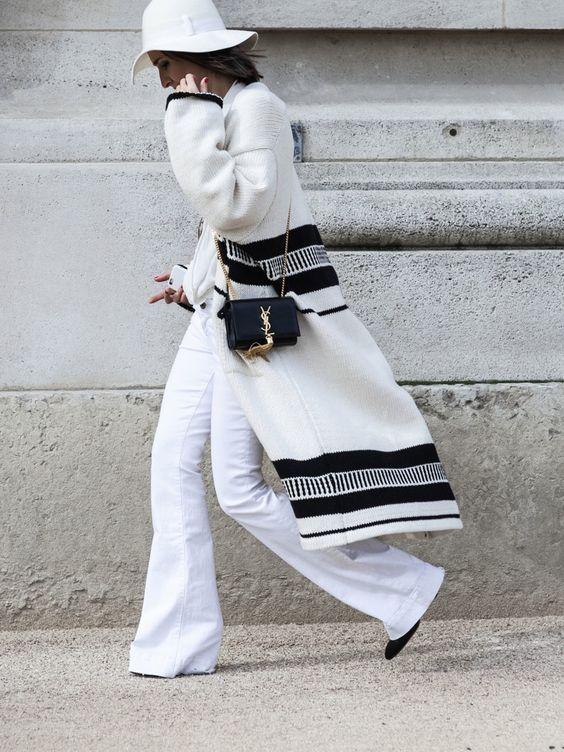 all white & poncho'd. #Golestaneh in Paris.