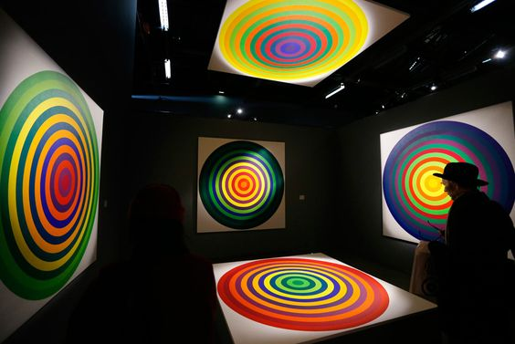 """A visitor looks at """"Serie 15, n°8"""", works of Argentinian artist Julio Le Parc, a pioneer of Op Art (Optical art), aged 85, at the Palais de Tokyo museum in Paris"""