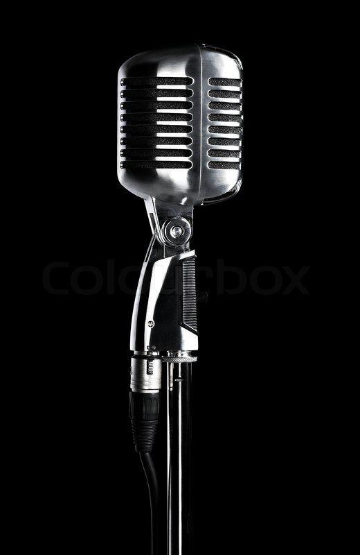 Stock Bild von 'Retro Mikrofon stehen isoliert auf schwarz'