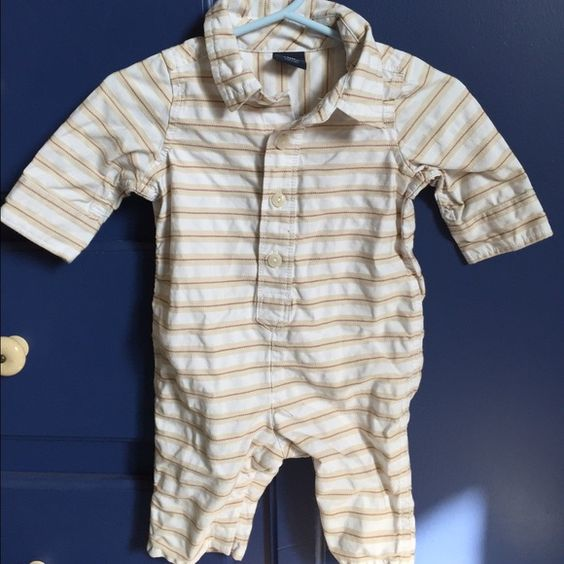 Baby Gap Jumpsuit (NWOT) A beige jumpsuit with horizontal lines. Snaps on the bottom and button down front. Never been used. No tags included. Baby Gap Other