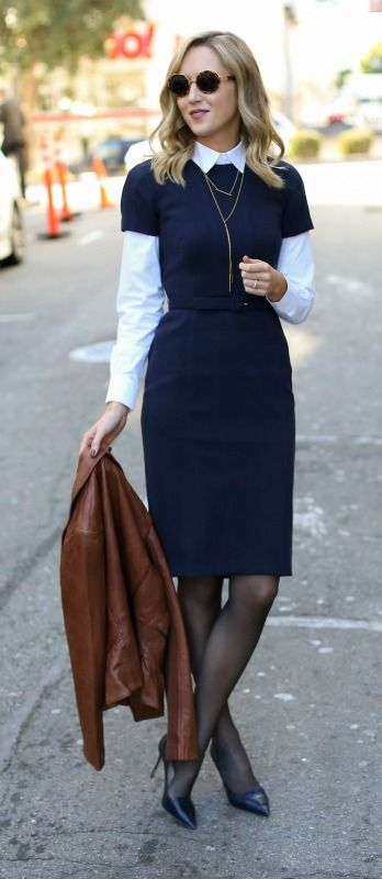 navy sheath dress with white button down, leather moto jacket, black tights, pointy toe pumps, sunglasses + gold jewelry {workwear, office style}: