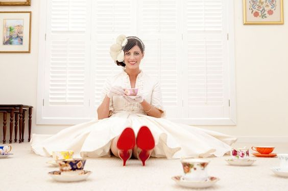 birdcage and red soles