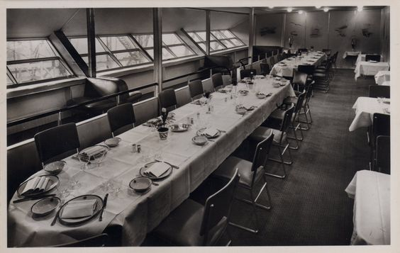 Dining room of the Hindenberg including silk wallpaper with scenes of Graf Zeppelin's flights to South America. From a detailed overview of the blimp's design at airships.net.: