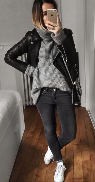 Black leather jacket, grey sweater, black jeans, and sneakers. (Audrey Lombard):