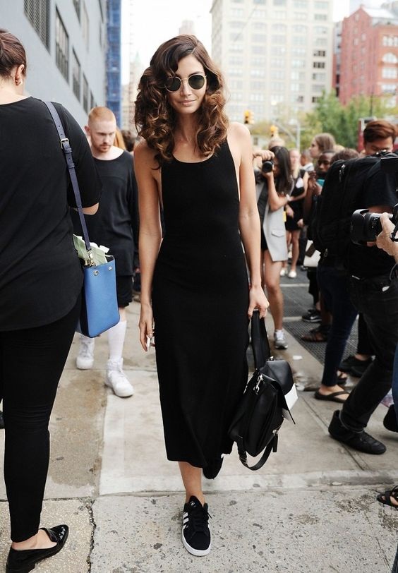 Lily Aldridge wears a black midi-dress with Adidas Original Campus 2 Sneakers.: