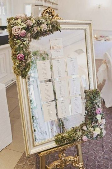 Mirror Wedding Seating Chart Idea Mirror Wedding Sign With Moss And Purple Flowers Pascale La Vi Wedding Table Plan Seating Chart Wedding Twilight Wedding