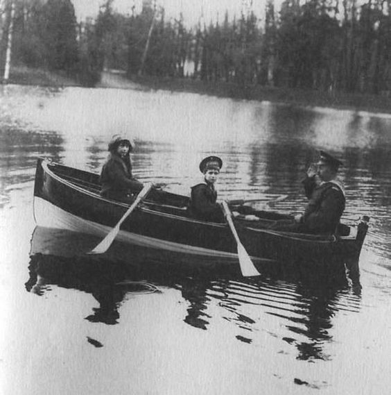 Grand Duchess Anastasia, Tsarevich Alexei and an Officer. Possibly in the lake within the ground of the Tsarskoe Selo park.