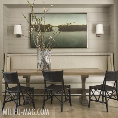 Upholstered dining seat in dining nook, black chairs