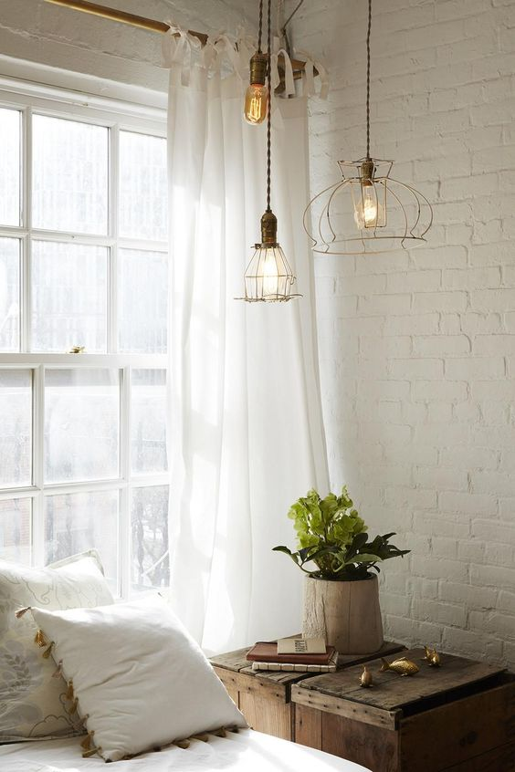 Painted brick wall in a rustic bedroom - Decoist