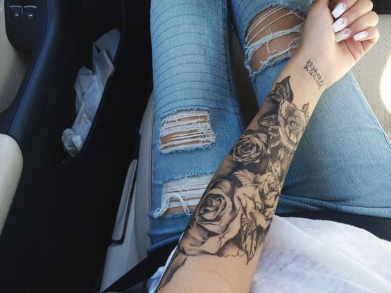 Love the depth of tone on the rose and the black shading in the background. I'd have roman numerals or elegant font on my wrist instead. I'd want the same placement but on my other arm and maybe less roses.: